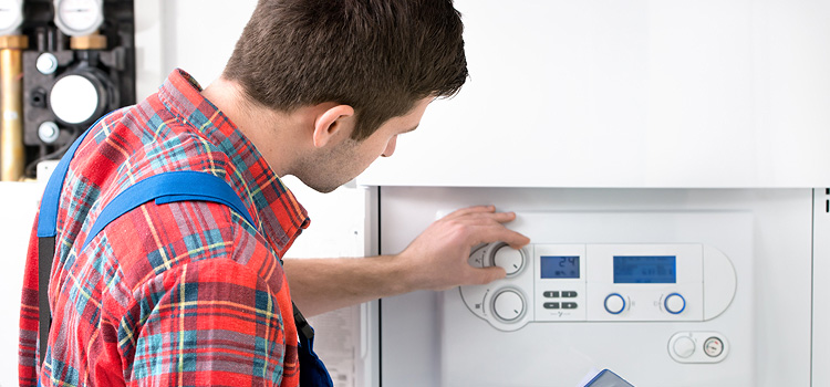 Man adjusting a dial for a central air conditioning system