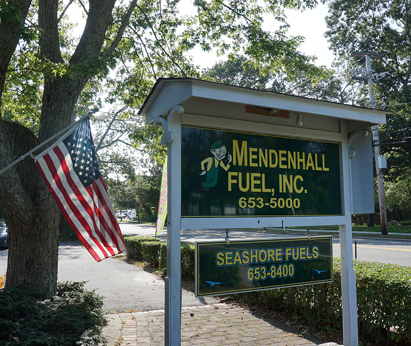 Mendenhall Fuel outdoor sign and American flag